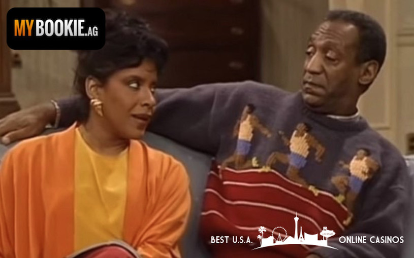 Claire and Heathcliff Huxtable on Couch